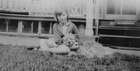A photograph of Rags with the daughter of an officer at Fort Jay, Governors Island, circa late 1920s.
